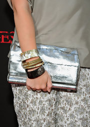 Annie Starke paired her silver ensemble with an arm full of bangle bracelets.