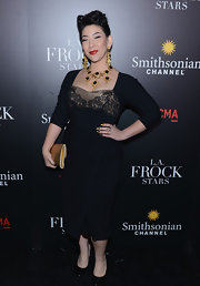 Shelly Lyn Erdmann rocked a figure-flattering little black dress with lace bust at the 'LA Frock Stars' premiere in LA.