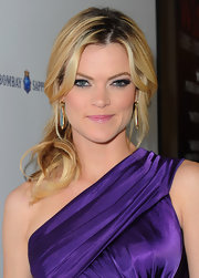 Missi Pyle wore her hair in a dressed-up version of the ponytail, complete with feminine face-framing waves, at a screening of 'The Artist.'