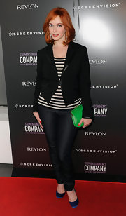 Christina Hendricks added pop to her casual red carpet look with a green leather kisslock clutch.