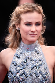 Diane Kruger looked ultra feminine with her wavy half-up hairstyle at the 'Sea of Trees' premiere in Cannes.