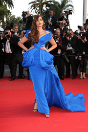 Sonam Kapoor ruled the 'Sea of Trees' Cannes red carpet in an electric-blue Ralph & Russo Couture off-the-shoulder gown with exaggerated hip detailing and a flowing train.