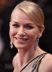 Naomi Watts styled her hair with a sleek side part at the front and a twisted bun at the back for the 'Sea of Trees' premiere in Cannes.