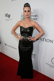 Katy Perry oozed goth glamour in a strapless black leather gown during the launch of the Parker Institute for Cancer Immunotherapy.