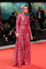 Kristen Stewart glammed up in a metallic fuchsia lace gown by Chanel Couture for the Venice Film Festival screening of 'Seberg.'