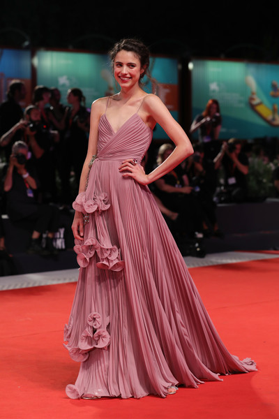 Margaret Qualley had a princess moment at the Venice Film Festival screening of 'Seberg' in a pleated mauve wrap gown by Gucci.