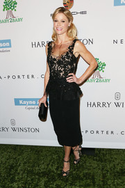 Julie Bowen finished off her ultra-girly look with black lace sandals by Jimmy Choo.