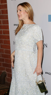 Drew Barrymore attended the Baby2Baby Gala carrying an elegant gold purse by Tory Burch.