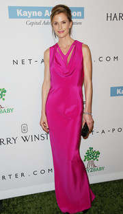 Annelise Peterson donned a cowl-neck evening dress in a striking fuchsia hue for the Baby2Baby Gala.