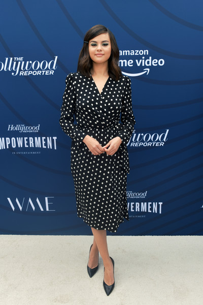 Selena Gomez Wrap Dress [the hollywood reporter,clothing,blue,dress,pattern,polka dot,fashion,footwear,design,electric blue,long hair,arrivals,selena gomez,hollywood,california,hollywood reporter,milk studios,empowerment in entertainment event]