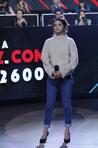 Selena Gomez Turtleneck [handout photo,fashion,footwear,human,event,shoe,outerwear,leg,neck,performance,sportswear,selena gomez,voice,concert for disaster relief,phone bank,somos live,los angeles,universal studios lot,california,one voice]
