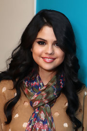 Selena Gomez added a touch icy pink to her look by patting on a bit of pastel gloss.