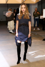 Jamie Chung hit the Self-Portrait fashion show wearing a navy pinstriped dress from the label.