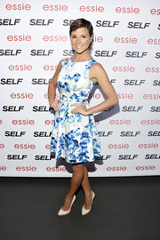 Diem Brown showed off a fit figure with this sleeveless, blue and white floral frock.