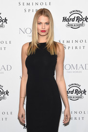 Hailey Clauson wore her hair down with a center part.