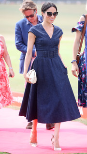 Meghan Markle kept it casual yet stylish in a belted denim dress by Carolina Herrera at the Sentebale Polo 2018.