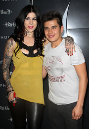 Kat Von D brightened her sexy black bondage stop with a sheer yellow tank.