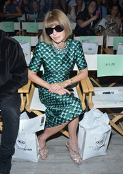Anna Wintour sat front row at the Serena Williams Signature Statement fashion show wearing a custom Prada print dress.
