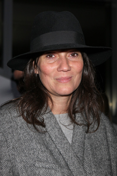 Emmanuelle Alt showed off her quirky side with a tall black hat with a lace sash as she attended the Sergio Rossi Presentation.