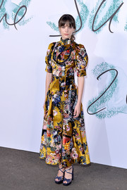 Stacy Martin chose an artsy Erdem print dress with puffed sleeves and a high neckline for the Serpentine Galleries Summer Party.