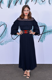 Ella Purnell was a classic beauty in a midnight-blue lace-yoke dress by Chanel at the Serpentine Galleries Summer Party.