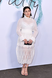 Charli XCX paired her top with a matching balloon skirt.