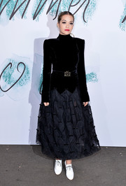 Rita Ora channeled the '80s with this black shoulder-pad dress by Chanel at the Serpentine Galleries Summer Party.