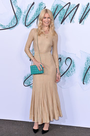 A turquoise chain-strap bag gave Claudia Schiffer's neutral outfit a nice pop of color.