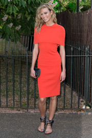 "Karlie Kloss completed her outfit with flat ankle-wrap sandals (her 6'1"" frame doesn't need the extra height anyway)."