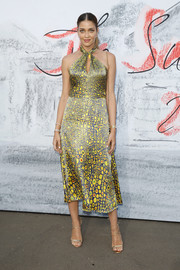 Strappy gold heels finished off Ana Beatriz Barros' look.