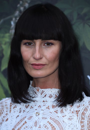 Erin O'Connor rocked blunt bangs and barely-there waves at the Serpentine Summer Party.