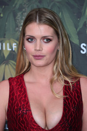 Kitty Spencer attended the Serpentine Summer Party wearing her hair in a straight center-parted style.