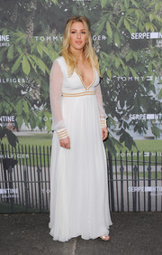 Ellie Goulding looked angelic (well, except for that plunging neckline) in a long-sleeve white maxi dress with gold trim during the Serpentine Summer Party.