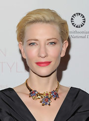 Cate Blanchett added loads of glitz and glam to her look with a multi-colored diamond statement necklace.