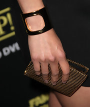 Aimee Garcia added a gilded touch to her look with a gold cuff bracelet.