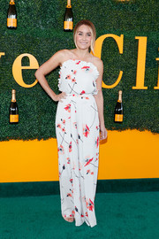 Lauren Conrad charmed in a Paper Crown print dress with spaghetti straps and a ruffle neckline during the Veuve Clicquot Polo Classic.