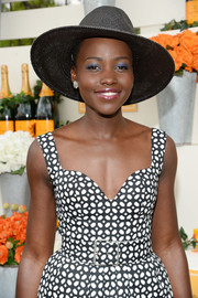 Lupita Nyong'o added a pop of color to her monochrome ensemble with some blue eyeshadow.