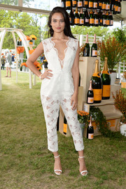 Shanina Shaik teamed her cute jumpsuit with simple white slim-strap sandals.