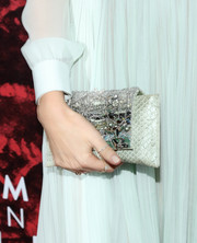 A bejeweled snakeskin clutch added major sparkle to Miranda Kerr's ensemble at the 'Romeo and Juliet' Broadway opening.