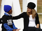 Shakira kept it casual and topped off her signature blonde waves with a textured black cap.
