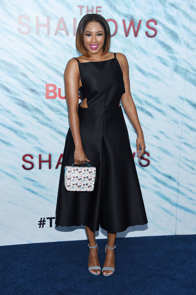 Alicia Quarles chose a pair of pastel-blue ankle-strap heels to team with her LBD.