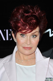 Sharon Osbourne sported a short curly 'do at the launch of her MAC collection.