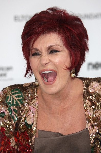 Sharon Osbourne Layered Razor Cut [hair,face,hairstyle,red hair,hair coloring,chin,lip,beauty,smile,blond,arrivals,sharon osbourne,california,los angeles,pacific design center,elton john aids foundation,oscar viewing party]