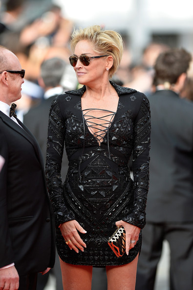 Sharon Stone Hard Case Clutch [the search premieres,the search,eyewear,clothing,fashion,sunglasses,hairstyle,blond,dress,street fashion,suit,premiere,sharon stone,cannes,france,premiere,cannes film festival]