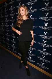Nina Agdal's black peplum top added some girlie flair to her all black look at the opening of American Eagle's Mexico City store.