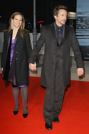 Susan Downey and Robert Downey Jr. attended the 'Sherlock Holmes' premiere wearing matching black wool coats.