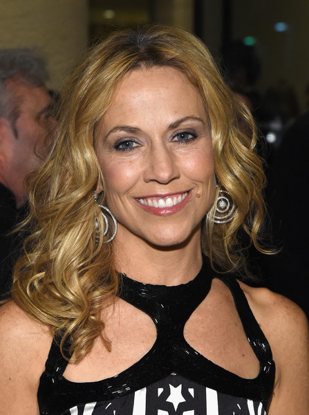 Sheryl Crow Medium Curls [red carpet,hair,blond,hairstyle,eyebrow,beauty,brown hair,long hair,smile,layered hair,feathered hair,martin bandier,sheryl crow,salute to industry icons,california,los angeles,pre-grammy gala and salute to industry icons]