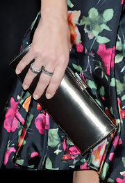 Kristen Davis went with a patent leather metal grey clutch while attending ShoWest. Her floral frock was ultra classy and sophisticated and her clutch fit the look perfectly.