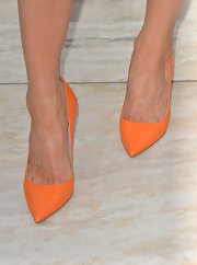 Bright orange pumps added a touch of summery color to Jaime Murray's look.