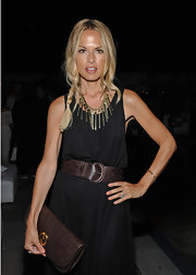 Rachel Zoe gave her black maxe a luxe '70s finish with a brown ostrich leather envelope clutch.